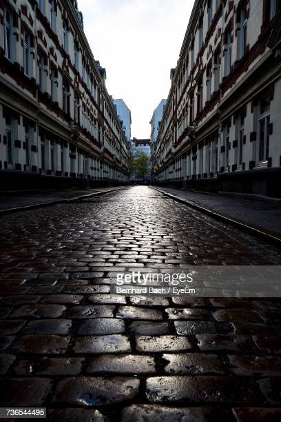 Cobblestone Street Amidst Buildings In City