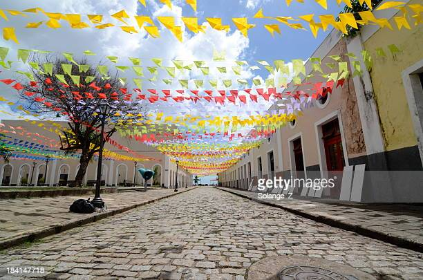 A cobblestone street decorated for a festival