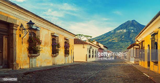 cobblestone street in antigua guatemal - guatemala stock pictures, royalty-free photos & images