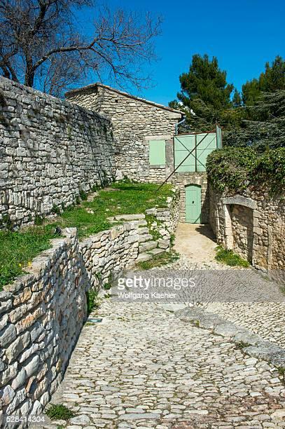 Cobblestone street in the hillside village of Lacoste in the Luberon in the ProvenceAlpesC��te d'Azur region in southeastern France