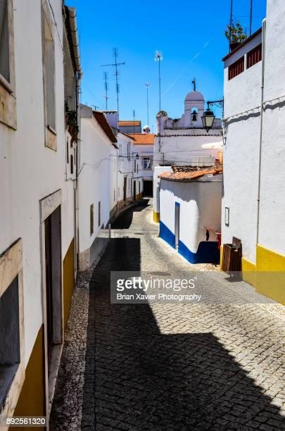 A cobblestone street in Vila Vicosa, Portugal