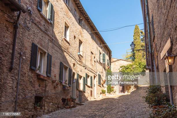 cobblestone street in volterra, italy - european culture stock pictures, royalty-free photos & images