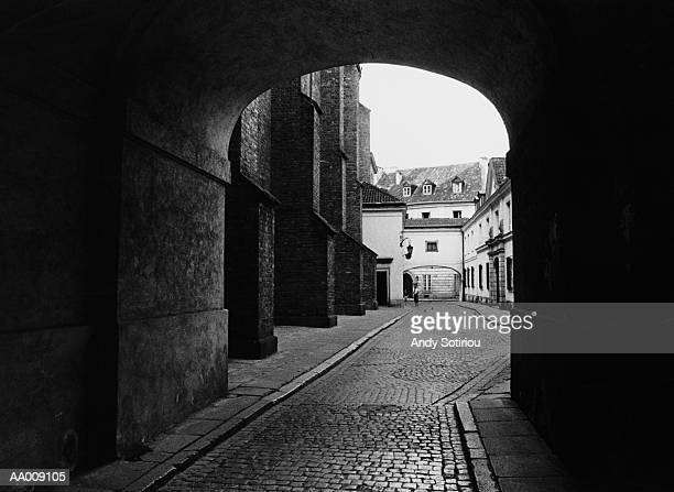 Cobblestone Street Under an Arch in Warsaw, Poland