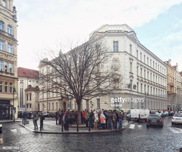 cobblestone street with pedestrians in prague old city historic center - astronomical clock prague stock pictures, royalty-free photos & images