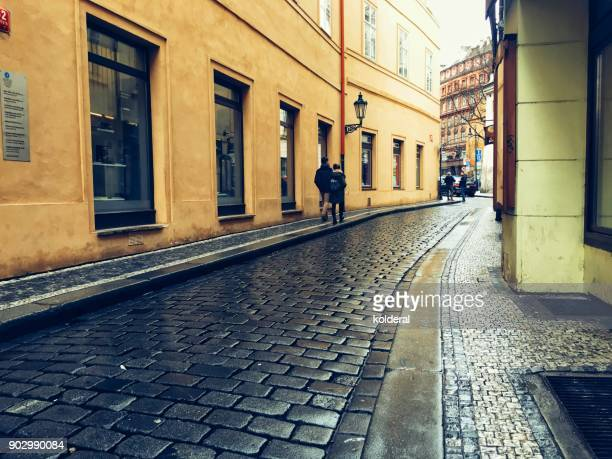 cobblestone street with pedestrians in Prague old city historic center
