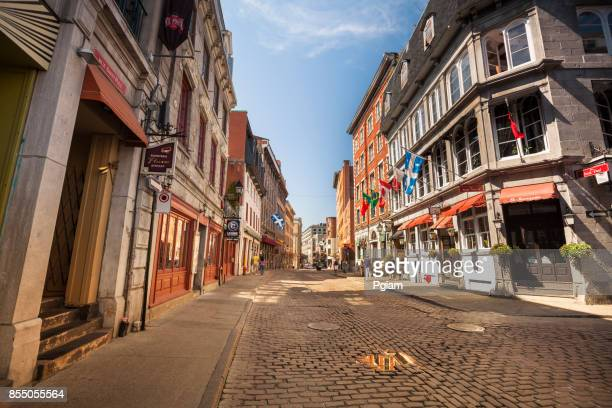 cobblestone streets in old montreal quebec canada - new orleans french quarter stock photos and pictures