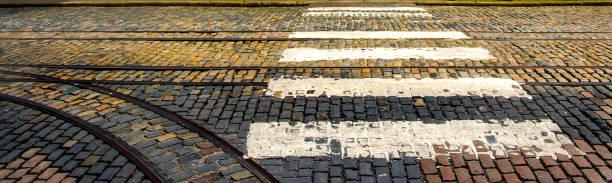 Cobblestones, Crosswalk and Tracks on a Street in Dublin Ireland