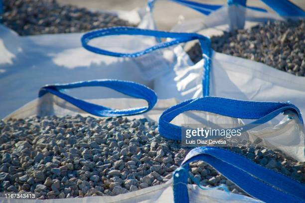 cobblestones inside of sacks - rubble stock pictures, royalty-free photos & images