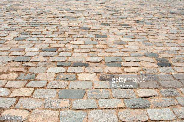 cobblestones - paving stone stock pictures, royalty-free photos & images