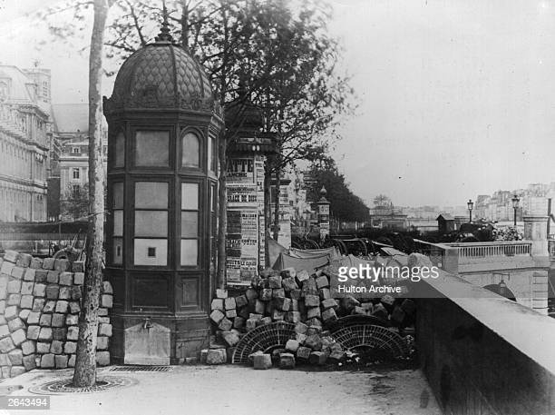 Cobblestones ripped from the streets and used for barricades on the Quai Pelletier and the Pont d'Arcole during the siege of the Paris Commune during...