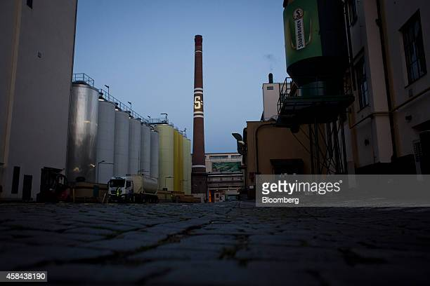 Cobblestones sit in the yard beside storage silos at the Pivovary Staropramen AS brewing company operated by Molson Coors Brewing Co in Prague Czech...