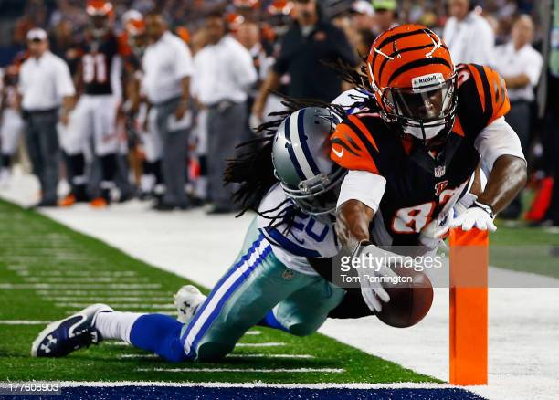 Cobi Hamilton of the Cincinnati Bengals dives into the end zone to score a touchdown against BW Webb of the Dallas Cowboys in the fourth quarter...
