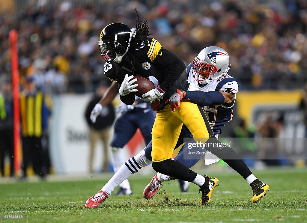 Cobi Hamilton #83 of the Pittsburgh Steelers is tackled by Logan Ryan #26 of the New England Patriots after a reception in the second half during the game at Heinz Field on October 23, 2016 in Pittsburgh, Pennsylvania.