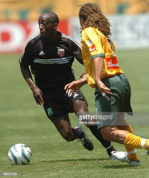 Cobi Jones of the Los Angeles Galaxy and John Wilson of DC United in action during their contest the at Home Depot Center in Carson California July...