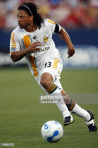 Cobi Jones of the Los Angeles Galaxy dribbles the ball up the field against FC Dallas during a MLS game on June 9, 2007 at the Pizza Hut Park in...