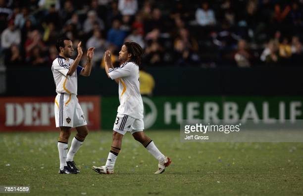 Cobi Jones of the Los Angeles Galaxy is congratulated by Landon Donovan after being substituted during the game against FC Dallas on September 23,...