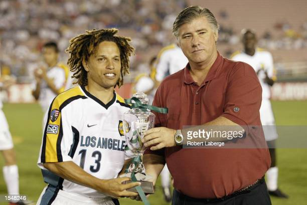 Cobi Jones of the Los Angeles Galaxy is presented with the Western Conference Champion Trophy prior to the start of the game against the Kansas City...