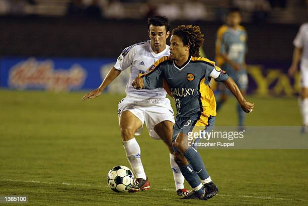 Cobi Jones of the Los Angeles Galaxy picks up a loose ball against Kerry Zavagnin of the Kansas City Wizards during the second half on August 21 2002...