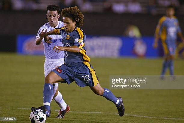 Cobi Jones of the Los Angeles Galaxy rushes past Kerry Zavagnin of the Kansas City Wizards during the second half on August 21 2002 at the Rose Bowl...