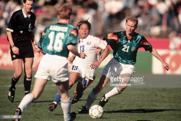 Cobi Jones of the USA and Dieter Eilts of Germany play in an international friendly match on December 18 1993 at Stanford Stadium in Palo Alto...