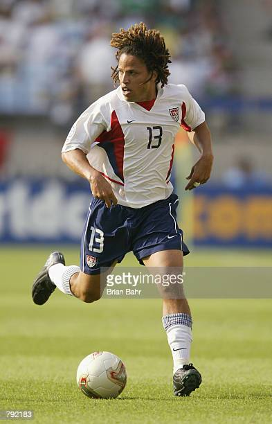 Cobi Jones of the USA runs with the ball during the FIFA World Cup Finals 2002 Second Round match between Mexico and the USA played at the Jeonju...
