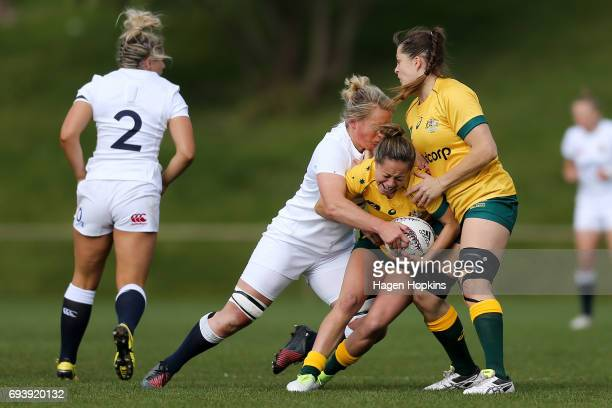 CobieJane Morgan of Australia is tackled by Izzy NoelSmith of England during the Women's International Test match between the Australian Wallaroos...