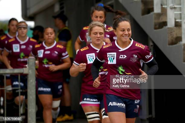 Cobie-Jane Morgan of the Reds runs out during the Super W Final match between the NSW Waratahs and the Queensland Reds at Coffs Harbour International...