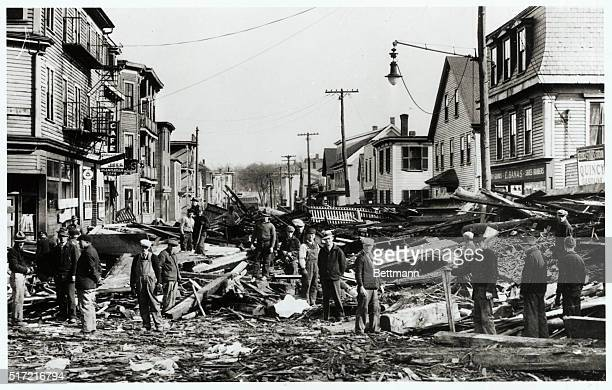 Coburn Street in the Centerville section of Lowell was littered and piled with floodflotsom when the waters of the Merrimac River receded and...