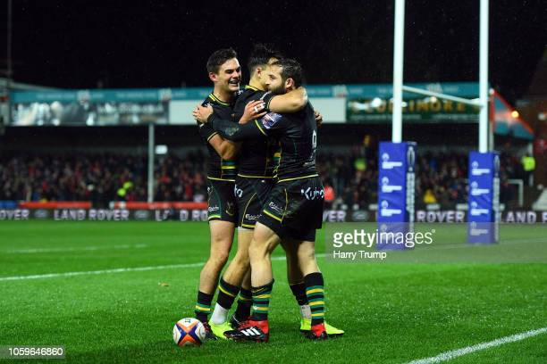 Cobus Reinach of Northampton Saints celebrates scoring his sides second try during the Premiership Rugby Cup match between Gloucester Rugby and...
