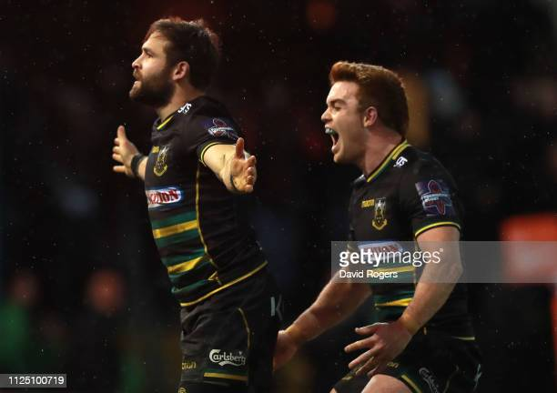 Cobus Reinach of Northampton Saints celebrates with team mate Andrew Kellaway after scoring his second try during the Premiership Rugby Cup match...
