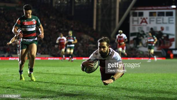 Cobus Reinach of Northampton Saints dives for the first try during the Gallagher Premiership Rugby match between Leicester Tigers and Northampton...