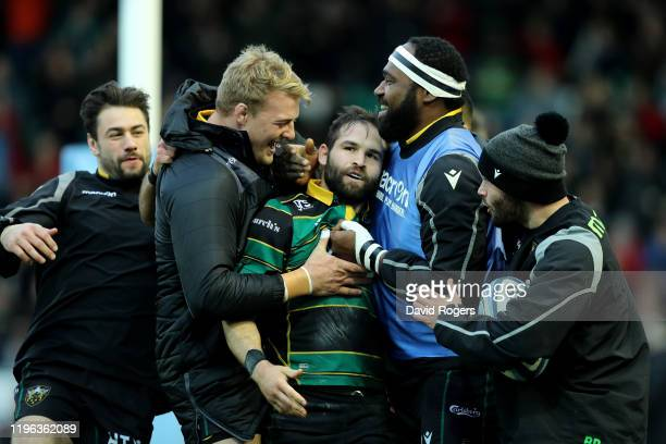 Cobus Reinach of Northampton Saints is mobbed by team mates after scoring their third try during the Gallagher Premiership Rugby match between...