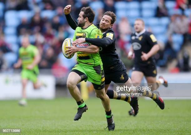 Cobus Reinach of Northampton Saints is tackled by Danny Cipriani of Wasps during the Aviva Premiership match between Wasps and Northampton Saints at...