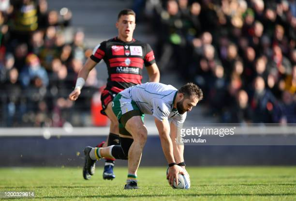 Cobus Reinach of Northampton Saints runs in to score his side's third try during the Heineken Champions Cup Round 6 match between Lyon Olympique...