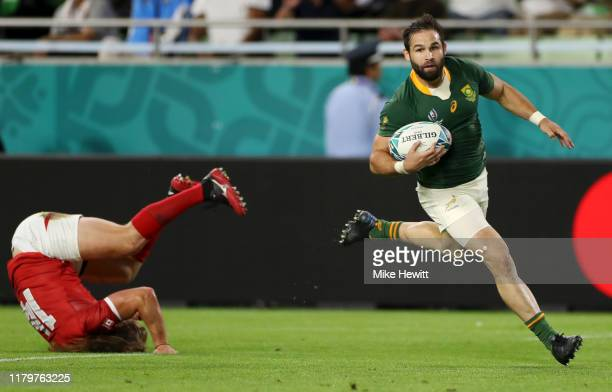 Cobus Reinach of South Africa breaks away from Jeff Hassler of Canada to score his team's third try during the Rugby World Cup 2019 Group B game...