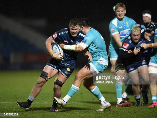 Cobus Wiese of Sale is tackled by Ethan Waller of Worcester during the Gallagher Premiership Rugby match between Sale Sharks and Worcester Warriors...