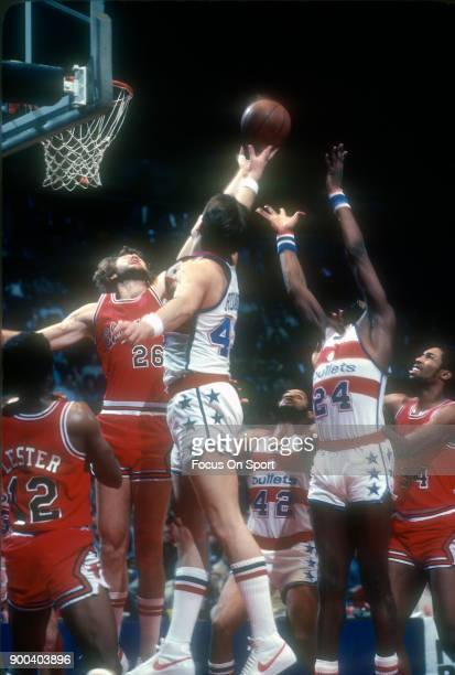 Coby Dietrick of the Chicago Bulls battles for a rebound with Jeff Ruland of the Washington Bullets during an NBA basketball game circa 1981 at the...