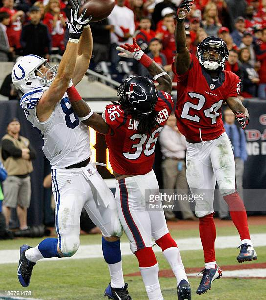 Coby Fleener of the Indianapolis Colts catches a pass for a two point conversion as he beats DJ Swearinger of the Houston Texans and Johnathan Joseph...