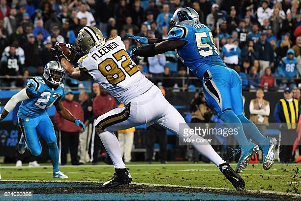 Coby Fleener of the New Orleans Saints makes a touchdown reception against the Carolina Panthers at Bank of America Stadium on November 17 2016 in...