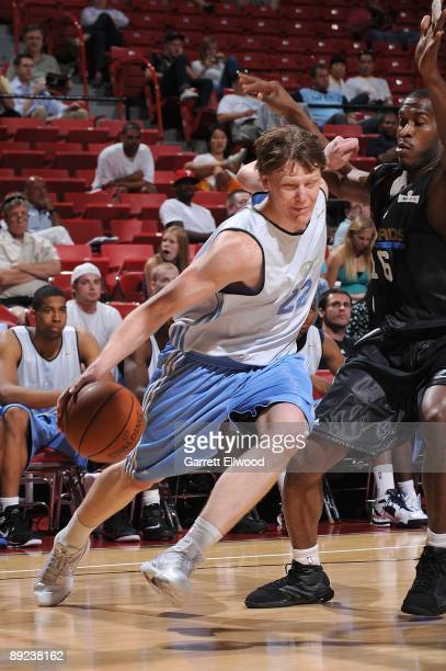 Coby Karl of the Denver Nuggets drives against Jason Rich of the Washington Wizards during NBA Summer League presented by EA Sports on July 15 2009...