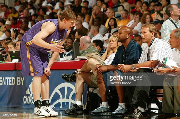 Coby Karl of the Los Angeles Lakers talks to Coaches Brian Shaw and Kurt Rambis during the game against the Milwaukee Bucks during the NBA Summer...