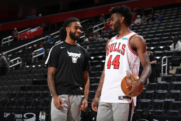 Coby White and Patrick Williams of the Chicago Bulls smile before the game against the Detroit Pistons on May 9, 2021 at Little Caesars Arena in...