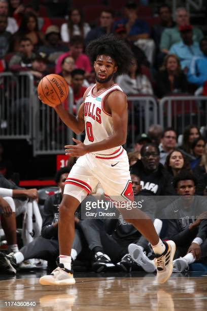Coby White of Chicago Bulls dribbles up court against the Milwaukee Bucks on October 7 2019 at the United Center in Chicago Illinois NOTE TO USER...