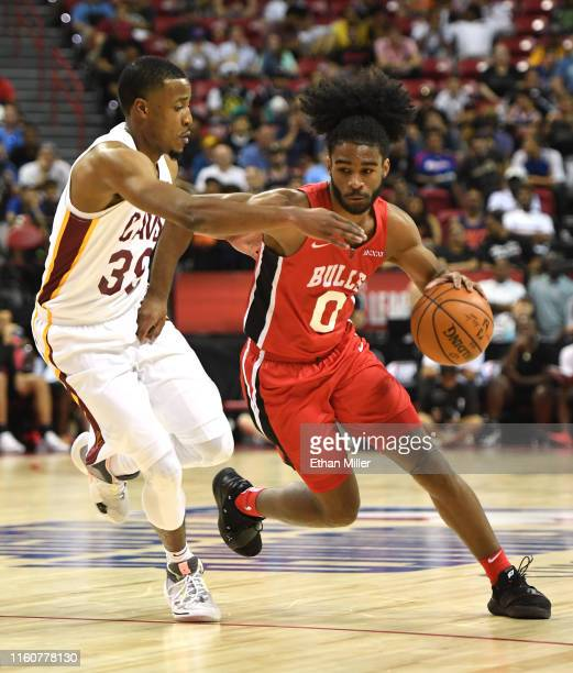 Coby White of the Chicago Bulls brings the ball up the court against MuhammadAli AbdurRahkman of the Cleveland Cavaliers during the 2019 NBA Summer...