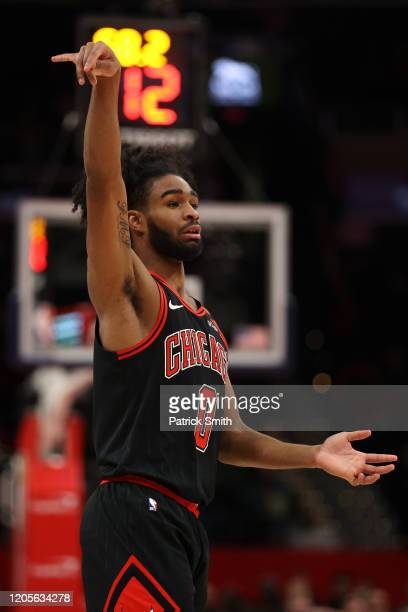 Coby White of the Chicago Bulls celebrates his threepointer against the Washington Wizards during the first half at Capital One Arena on February 11...