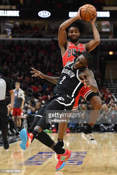 Coby White of the Chicago Bulls collides with Taurean Prince of the Brooklyn Nets during the first half of a game at United Center on November 16...