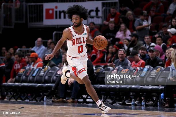 Coby White of the Chicago Bulls dribbles the ball in the fourth quarter against the Atlanta Hawks during a preseason game at the United Center on...