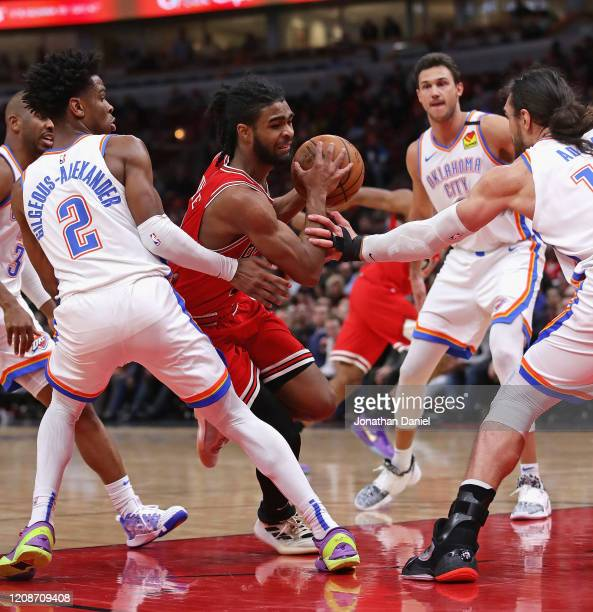 Coby White of the Chicago Bulls drives in between Chris Paul Shai GilgeousAlexander Danilo Gallinari and Steven Adams of the Oklahoma City Thunder at...
