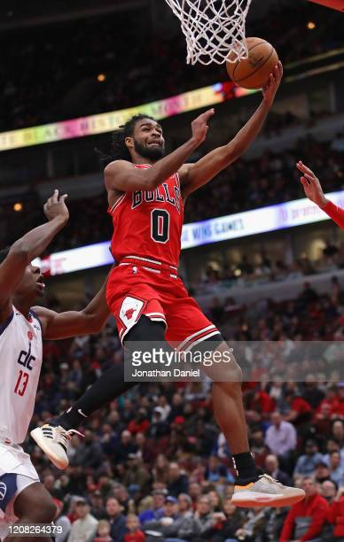 Coby White of the Chicago Bulls drives to the basket over Thomas Bryant of the Washington Wizards at the United Center on February 23 2020 in Chicago...
