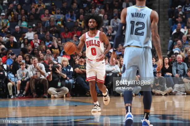 Coby White of the Chicago Bulls handles the ball against Ja Morant of the Memphis Grizzlies on October 25 2019 at FedExForum in Memphis Tennessee...